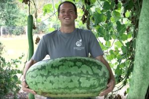 Brandon Huber holding a giant watermelon